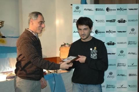 Sergio Bellomo, Secretary, presenting the award to Mr Santiago Ezcurra