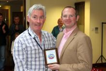 Chairman of IPMS Ireland, Mr. Simon Nolan, presenting the award to Mr Ray Flynn